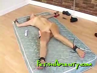 Tied up chick on a mattress gets whipped and choked