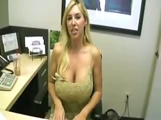 Busty blonde secretary sucking cock in the office