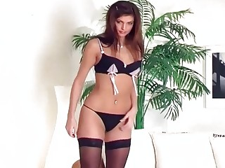 Teasing glamour babe in panties and stockings