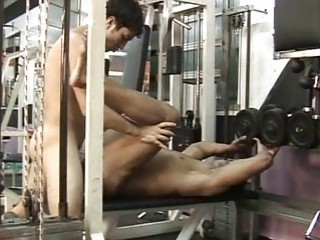 Gay hunk riding a cock in the gym