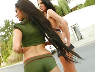Two bootylicious brunettes playing with one hard cock