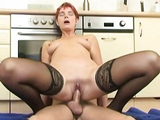 Curvy German mature woman in stockings fucks in the kitchen