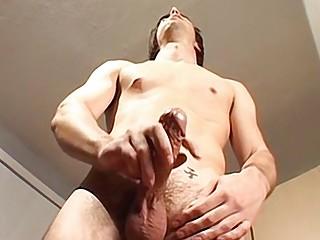 Hairy jock cumming hard on his belly