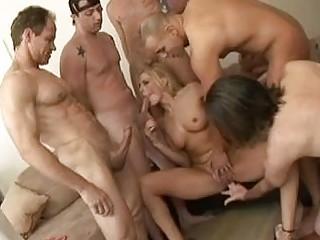 SKinny blonde with big tits enjoys in gang bang action