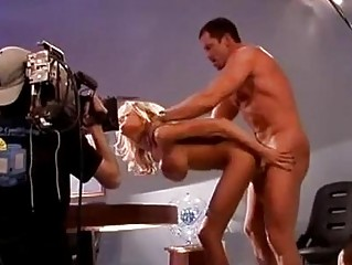 Busty blonde pornstar gets rammed on table by muscled hunk