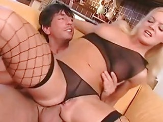 Teasing blonde in sexy undies and fishnet stockings gets her ass banged
