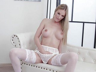 Glamorous woman in white lingerie rubs her tight wet pussy