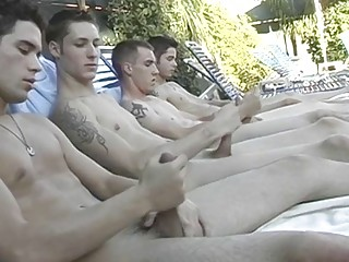 Young males jerking their big dicks off together