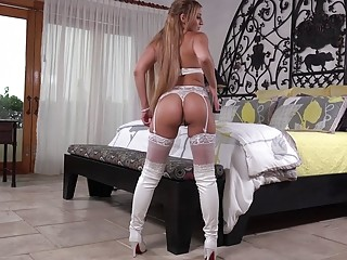 The hottest blonde babe wears white lingerie and jerks off