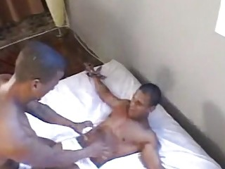 Submissive black gay restrained for feet tickle torture